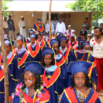 Graduating kindergarten pupils make their way to the Hall