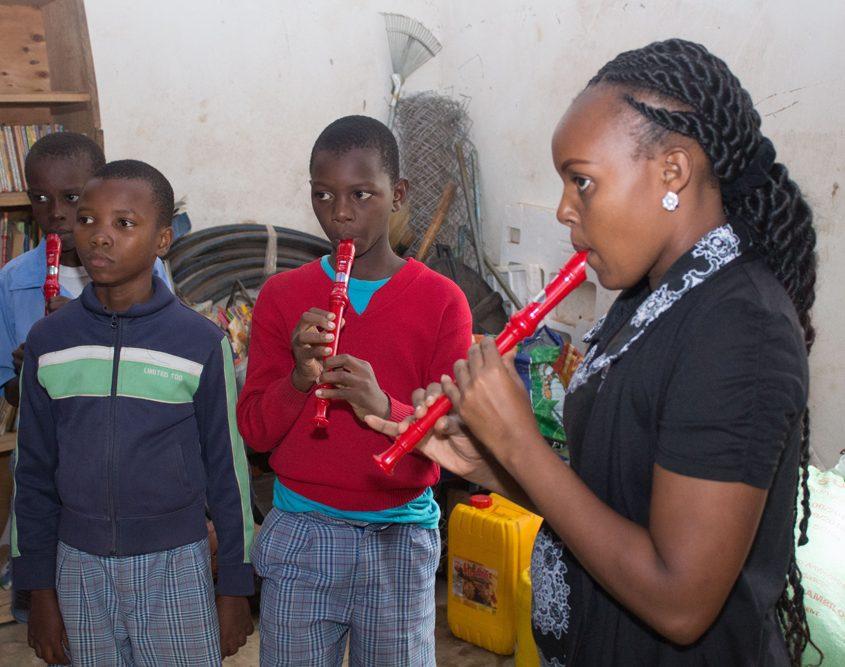 Teacher Christine learning the recorder