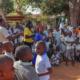 Teachers and children cheering on