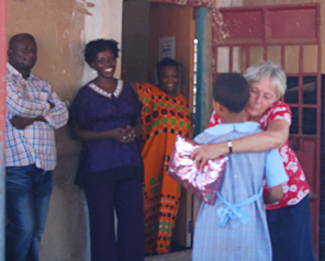 Janette hugging a DGS child