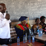 Jacob Boaz, School Director, welcomes Ms Mishi Mboko, guest of honour