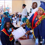 Ms Mishi Mboko, guest of honour, presents the certificates