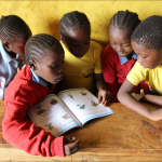 5 pupils sharing a book