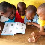 5 pupils sharing a book