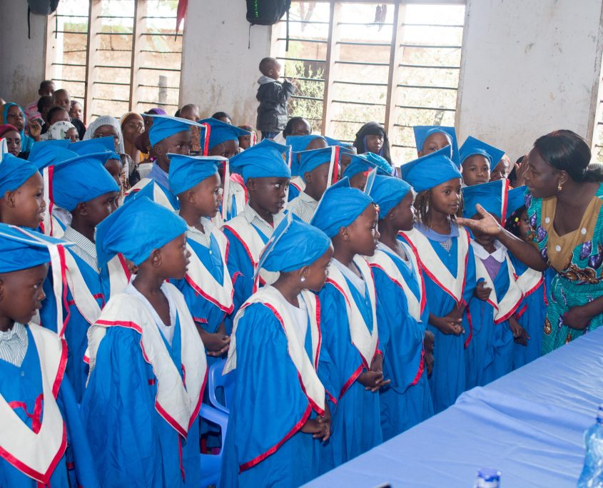 KG3 in blue graduation gowns